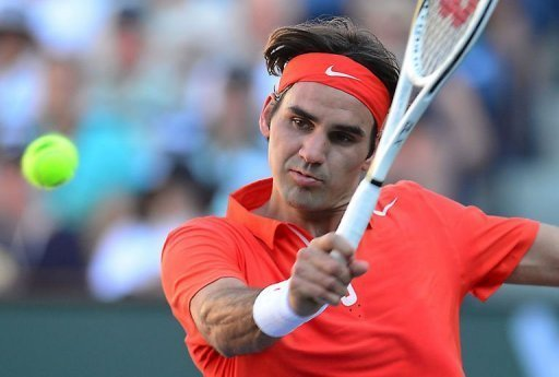 Roger Federer returns against Ivan Dodig at Indian Wells on March 11, 2013