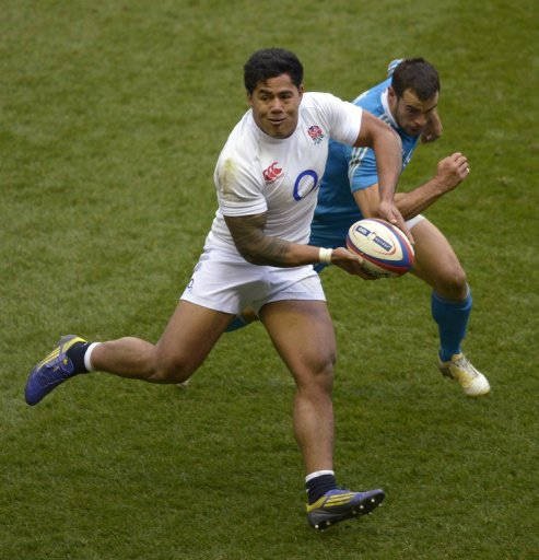 England centre Manu Tuilagi runs with the ball in front of Italy centre Gonzalo Canale at Twickenham on March 10, 2013