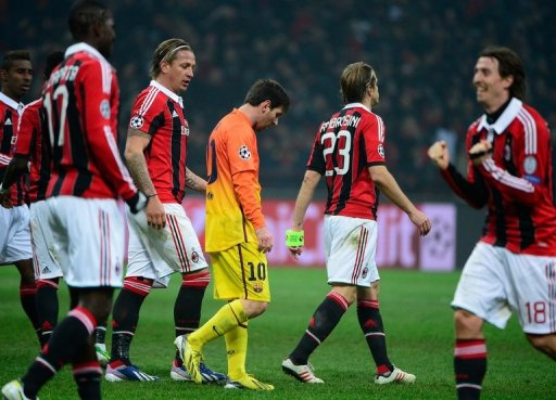 Barcelona forward Lionel Messi (C) cuts a dejected figure in the 2-0 defeat at AC Milan on February 20, 2013