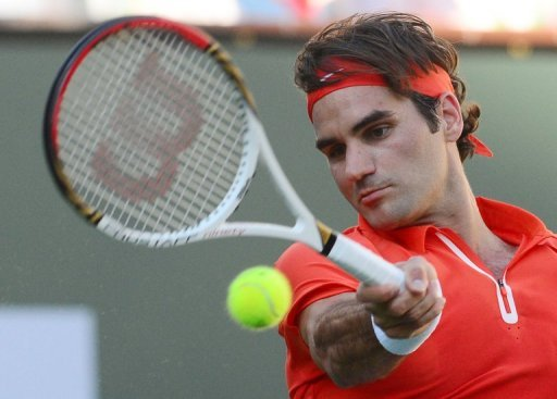 Roger Federer hits a forehand return against Ivan Dodig at Indian Wells on March 11, 2013