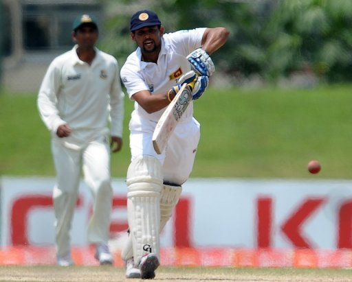 Tillakaratne Dilshan plays a shot during the final day of the opening Test against Bangladesh on March 12, 2013 in Galle