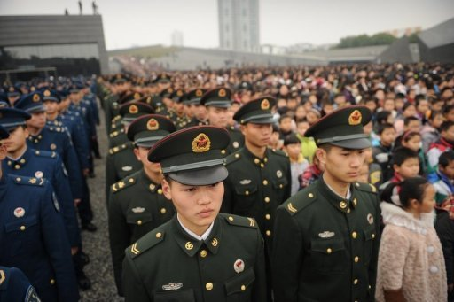 Military personnel attend a ceremony on the 75th anniversary of the Nanjing massacre, China, December 13, 2012