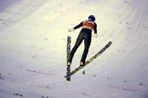 Gregor Schlierenzauer lands after his first jump in Kuopio, Finland, on March 12, 2013