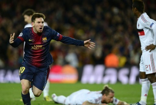Barcelona's Lionel Messi celebrates his second goal against Milan on March 12, 2013