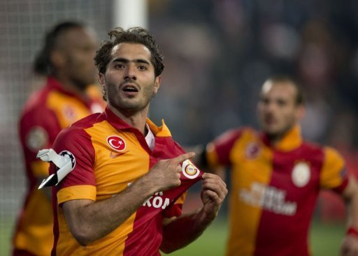 Galatasaray's Hamit Altintop celebrates scoring in Gelsenkirchen on March 12, 2013