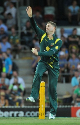 Michael Clarke bowls during their one-day International against the West Indies in Canberra on February 6, 2013