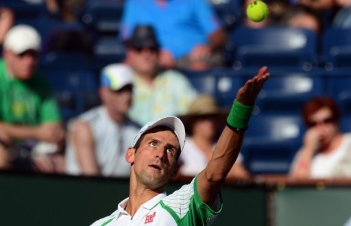 Novak Djokovic serves against Grigor Dimitrov at the BNP Paribas Open in Indian Wells on March 12, 2013
