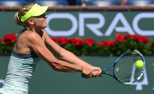 Maria Sharapova hits a backhand return at the BNP Paribas Open in Indian Wells on March 12, 2013