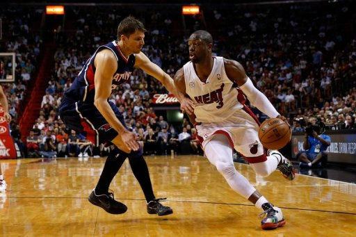 Dwyane Wade of the Miami Heat drives against Kyle Korver of the Atlanta Hawks on March 12, 2013