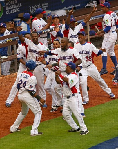 The Dominican Republic celebrate the winning run in the World Baseball Classic against Italy on March 12, 2013