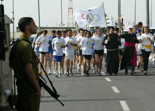 Competitors and church representatives take part in a marathon from Bethlehem to Jerusalem's Old City on April 14, 2005