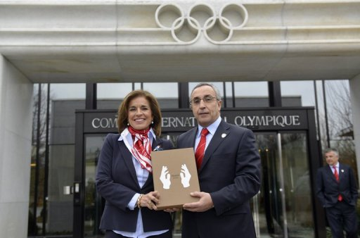 Members of the delegation of Madrid bid Ana Botella and Alejandro Blanco, IOC member pose in Lausanne on January 7, 2013