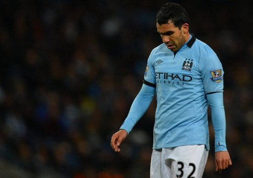 Manchester City's Carlos Tevez reacts at the Etihad Stadium in Manchester, on March 9, 2013