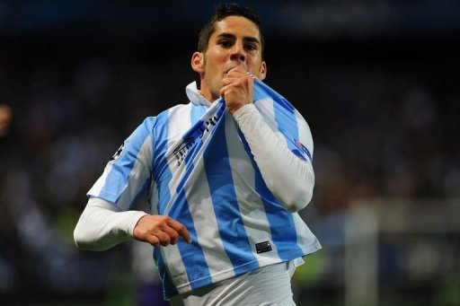 Malaga's Isco celebrates after scoring in Malaga on March 13, 2013