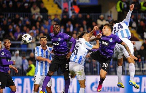 Malaga's Roque Santa Cruz (R) scores the second goal in Malaga on March 13, 2013