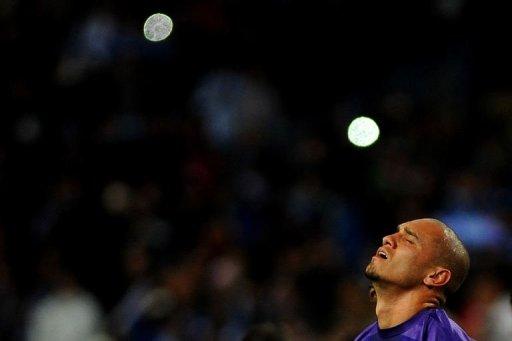 Porto's Maicon reacts after losing at La Rosaleda stadium in Malaga on March 13, 2013