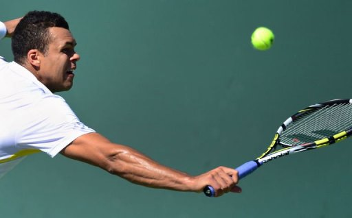 Jo-Wilfried Tsonga reaches for a backhand return against Milos Raonic in Indian Wells, California on March 13, 2013