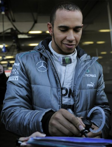 Lewis Hamilton signs autographs during testing on February 20, 2013