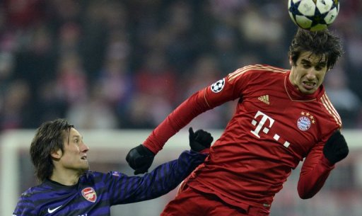 Bayern Munich's Javier Martinez out-jumps Tomas Rosicky during the UEFA Champions League match on March 13, 2013
