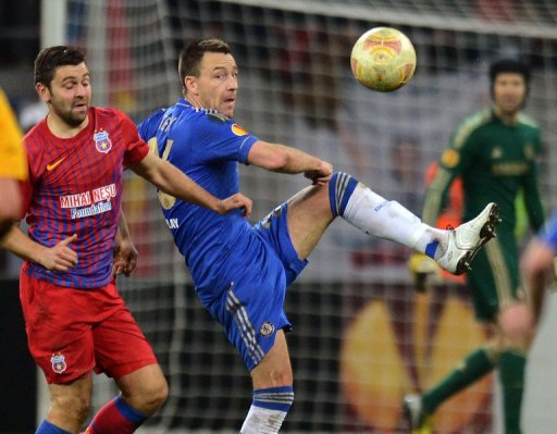 John Terry (R) hooks the ball clear against  Steaua Bucharest on March 7, 2013