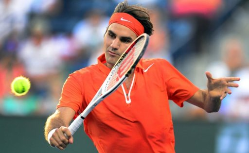 Roger Federer hits a backhand return against Stanislas Wawrinka at the BNP Paribas Open on March 13, 2013