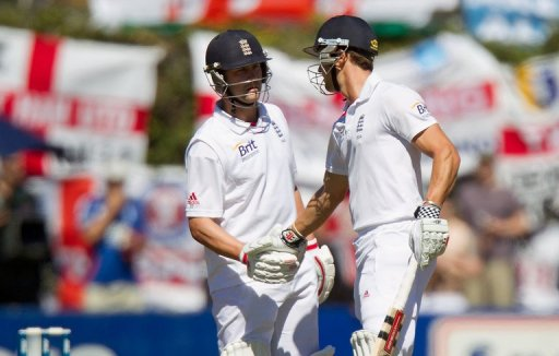 Nick Compton (R) earns a handshake from Jonathan Trott as the pair hit half centuries on March 14, 2013