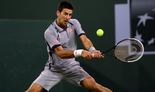 Novak Djokovic of Serbia hits a backhand return against Sam Querrey in Indian Wells, California on March 14, 2013