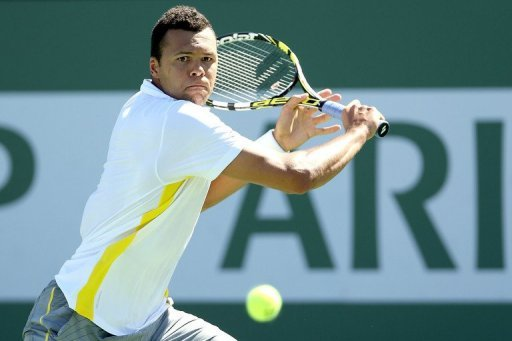 Jo-Wilfried Tsonga of France returns a shot to Milos Raonic 13 in Indian Wells, California, on March 13, 2013