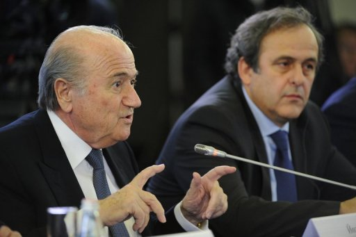 Sepp Blatter (left) and European counterpart Michel Platini in St Petersburg on January 19, 2012