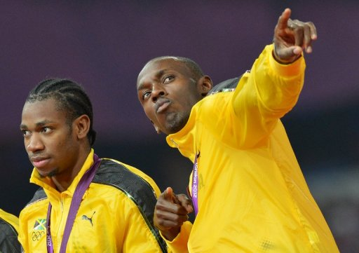 Jamaica's Usain Bolt and Jamaica's Yohan Blake (L) pose during the London 2012 Olympic Games on August 11, 2012