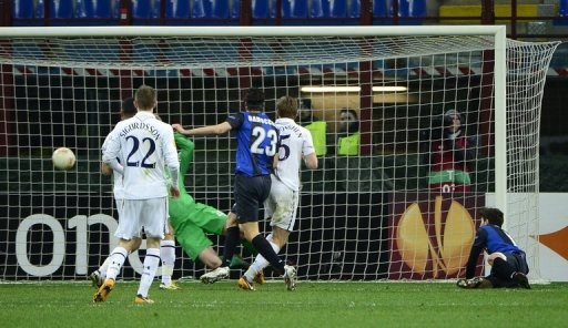 Inter Milan's Riccardo Alvarez (R) scores during their European Cup match against Tottenham, on March 14,  2013