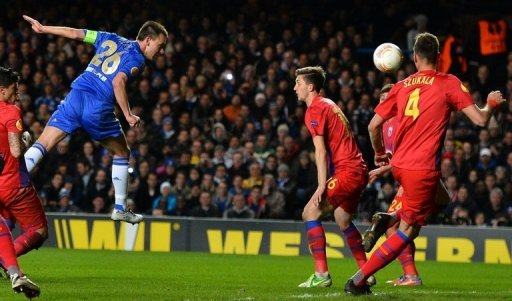 Chelsea's John Terry (L) heads the ball into the net against Steaua Bucharest at Stamford Bridge on March 14, 2013