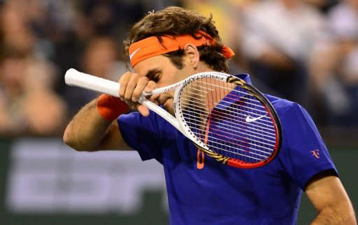 Roger Federer reacts after losing a point against Rafael Nadal on March 14, 2013 in Indian Wells