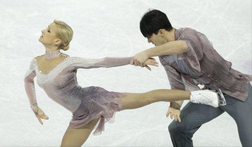 Tatiana Volosozhar and Maxim Trankov of Russia compete, March 15, 2013 in Canada
