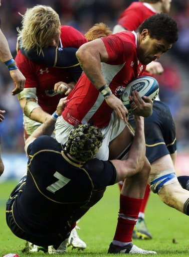 Wales's Toby Faletau (R) is tackled by Scotland's Kelly Brown (L), in Edinburgh, on March 9, 2013