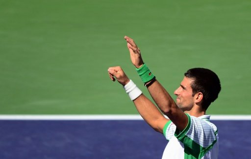 Novak Djokovic celebrates his victory over Jo-Wilfried Tsonga, in Indian Wells, California, on March 15, 2013