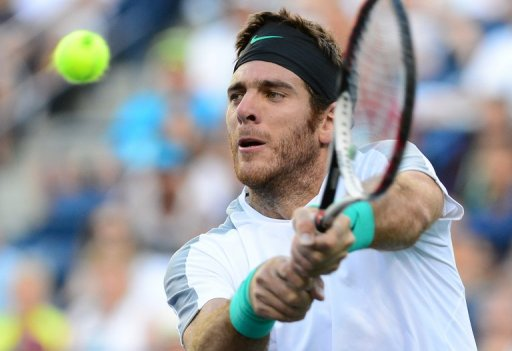 Juan Martin Del Potro hits a return to Andy Murray, in Indian Wells, California, on March 15, 2013