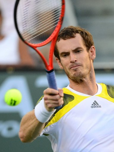 Andy Murray hits a forehand return to Juan Martin del Potro, in Indian Wells, California, on March 15, 2013