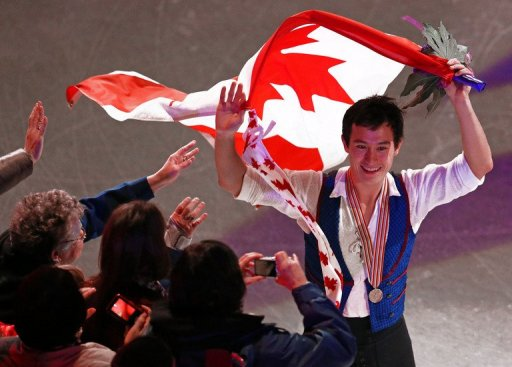 Patrick Chan celebrates his gold title at the World Figure Skating Championships in London, Ontario, on March 15, 2013