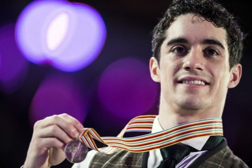 Javier Fernandez celebrates with his Bronze medal, in London, Ontario, on March 15, 2013