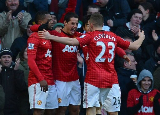 Manchester United players celebrate a goal during the match against Chelsea in Manchester, March 10, 2013