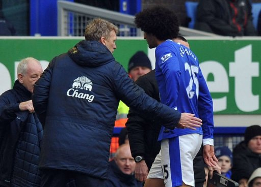 Everton manager David Moyes greets Marouane Fellaini during the match against Wigan Athletic in Liverpool March 9, 2013