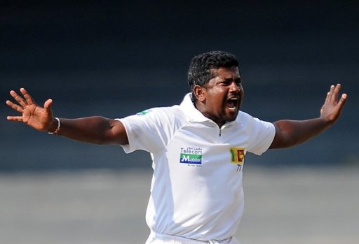 Sri Lanka's Rangana Herath appeals for a wicket during the second Test against Bangladesh in Colombo, on March 16, 2013