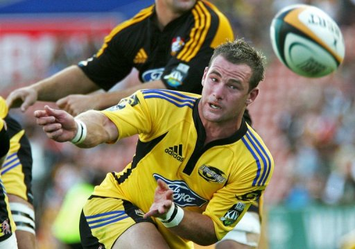 Hurricanes half back Alby Mathewson passes the ball on February 9, 2007