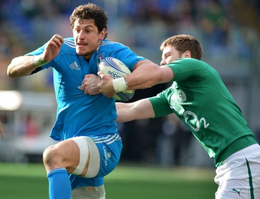 Italy's flanker Alessandro Zanni is tackled by Ireland's lock Iain Henderson (R) in Rome on March 16, 2013