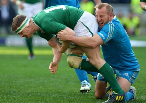 Ireland's centre Brian O'Driscoll (L) is tackled by Italy's hooker Leonardo Ghiraldini in Rome on March 16, 2013