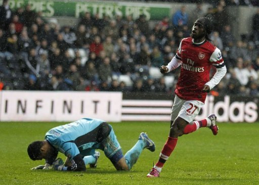 Arsenal's striker Gervinho (R) celebrates scoring a goal at The Liberty Stadium in Swansea, Wales, on March 16, 2013