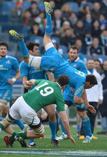 Italy's scrum-half Edoardo Gori (R) is tackled by Ireland's lock Devin Toner in Rome on March 16, 2013