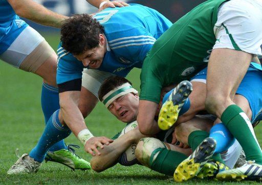 Ireland's centre  Brian O'Driscoll is tackled by Italy's flanker Alessandro Zanni (L) in Rome on March 16, 2013