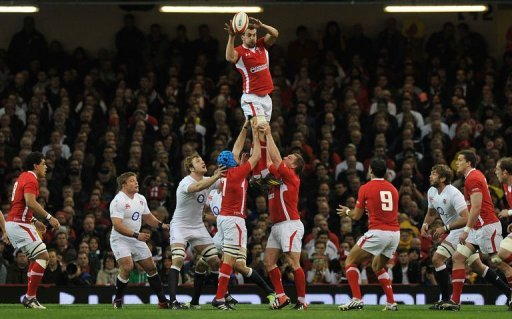 Wales's flanker Sam Warburton (C) takes the ball during a line-out in Cardiff on March 16, 2013